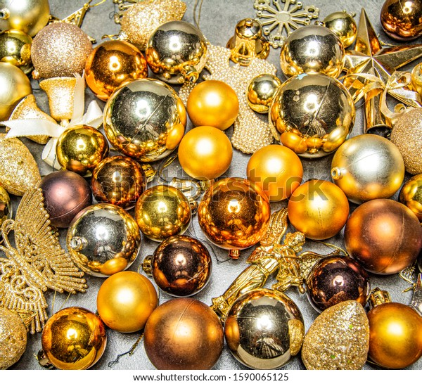 Cluster of Golden Christmas Baubles on a  Grey Background  with copy space - Image