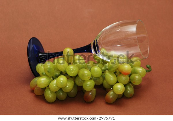 Cluster of green grapes and wine  glass