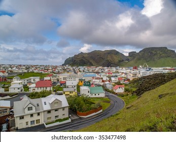 Cluster of houses in front of mountain at Heimaey, Vestmannaeyjar, Iceland. Also known as The Westman Islands.