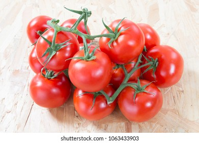 cluster of small red cherry tomatoes