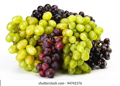 clusters of white and black grapes in a basket on a white background