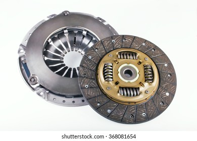 Clutch disc, clutch cover for car on a white background. Spare parts for shop, aftermarket, OEM. New spare parts for shop. Transmission auto spare parts for car. Isolated auto spare parts.