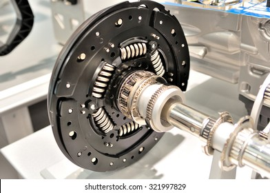 Clutch plate on an axle with bearing.