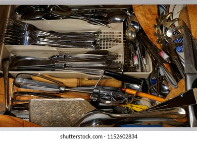 Cluttered cutlery drawer, a lifetime of useful stuff but none of it can be found when it's needed