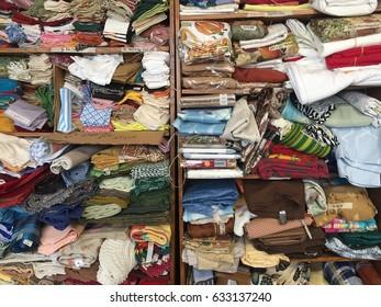 Cluttered Napkins on Shelves
