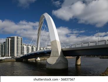 The Clyde Arc bridge in Glasgow, Scotland, against a cloudscape