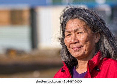 Clyde River, Baffin Island, Canada - August 20th, 2019: Portrait of a local inuit woman outdoors in Clyde River, Nunavut, Canada.