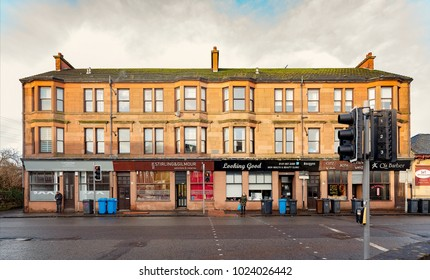 CLYDEBANK, SCOTLAND - JANUARY 20, 2018: A red sandstone tenement at the bottom end of Kilbowie Road in Clydebank.