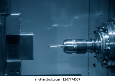 The  CMM touch probe  attach on the horizontal CNC machine spindle for quality control .CNC milling machine and quality concept.
