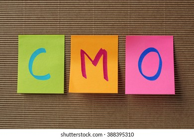 CMO (Chief Marketing Officer) acronym on colorful sticky notes