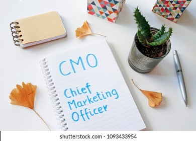 CMO Chief Marketing Officer written in notebook on white table
