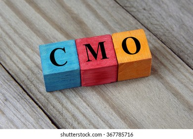CMO text (Chief Marketing Officer) on colorful wooden cubes