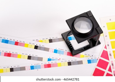 CMYK Color scales and loupe used for printing process
