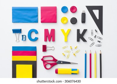 CMYK concept with graphic designer objects. view form above