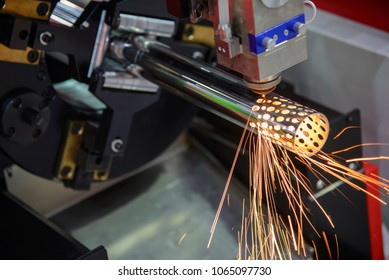 The CNC fiber laser cutting machine cutting the stainless tube,pipe for make holes.