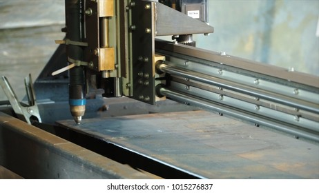 CNC Laser Plasma. Clip. Laser plasma cutting of metal modern technology in process at metalworking manufacturing plant male worker