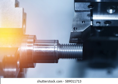 The CNC lath or Turning machine cutting the thread with the abstract lighting effect scene