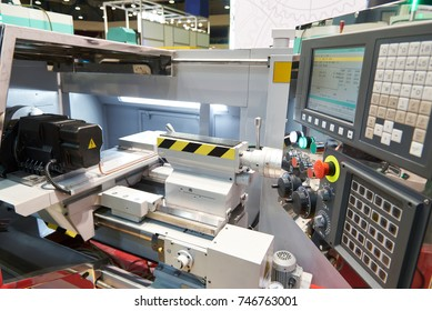 CNC lathe with cutters and workpiece