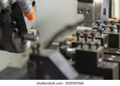 The CNC lathe machine cutting the metal  shaft parts