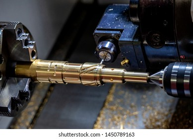The CNC lathe machine cutting the slot groove by milling turret. The metal working operation by turning machine cutting the groove the brass shaft.