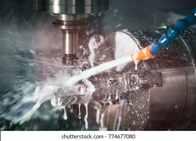 CNC lathe machine for industry. Metalworking workshop on lathe grinder machine. Metalworking CNC milling machine. Industrial and Technology concept.