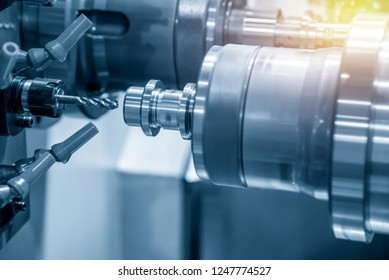 The CNC lathe machine making the thread  at the steel shaft by tapping tool .Hi-technology automotive part manufacturing process.