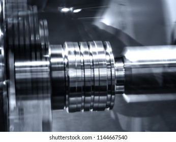 CNC lathe machine (Turning machine) cutting metal screw thread part .Hi-precision CNC machining concept.