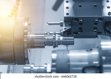 The CNC lathe machine (Turning machine) while drilling the metal rod with the drill and center drill tool .The hi-technology machining concept.