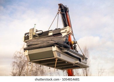 Cnc machine  hanging on hook crane.