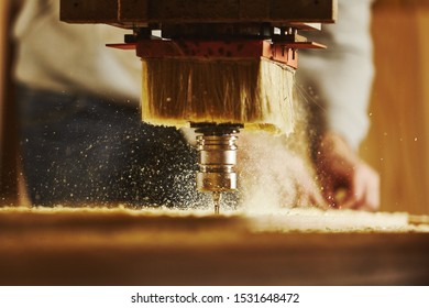 Cnc machine working, cutting wood. Woodwork industry.