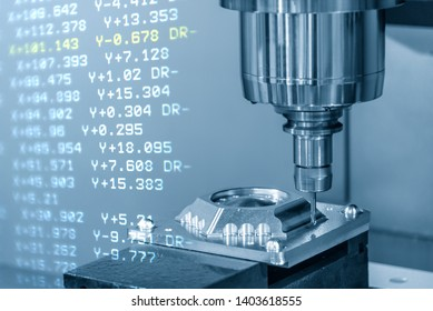 The CNC machining centre with the G-code data background. The CNC milling machine cutting the mould parts.