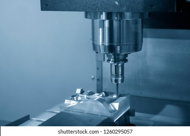 The CNC milling machine cutting the injection mold part by solid ball end mill tool. Mold manufacturing process.