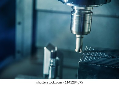 The CNC milling machine cutting the mold part in roughing   process with the index-able radius end-mill tool.Hi-technology manufacturing process.