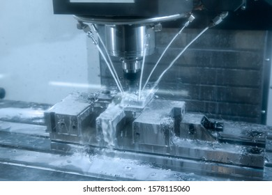 CNC milling machine cutting the tire mold part with the solid ball end-mill tool and coolant fluid