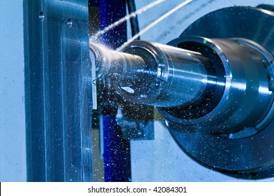A CNC milling machine milling heads in metal industry