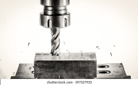 cnc milling machine - spindle with cutter, flying metal splinters, versions: monochrome on a white background, accented details and structure