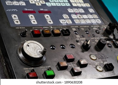 CNC operation panel through a long time use.Selective focus.