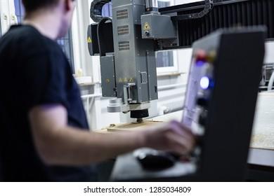 CNC operator while programming machine