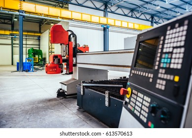 CNC Plasma cutter machine control panel in big metal industrial hall