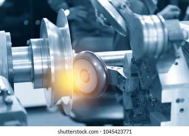 The CNC  spinning machine forming the part with lighting effect in light blue scene
