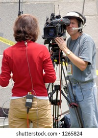 CNN reporter and camera crew at Los Angeles illegal emigrant rally. May 1st 2006