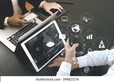 co working team meeting concept,businessman using smart phone and digital tablet and laptop computer and name tag in modern office with virtual icon graph and chart