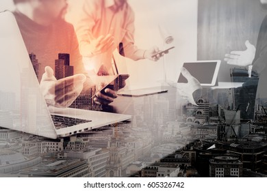 co working team meeting concept,businessman using smart phone and digital tablet and laptop computer in modern office with London city exposure