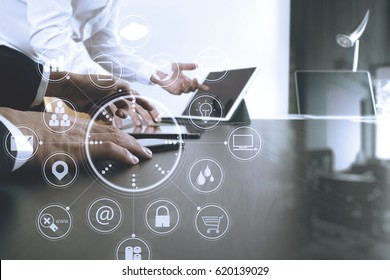 co working team meeting concept,businessman using mobile phone and digital tablet and laptop computer in modern office with virtual icon diagram
