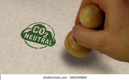 CO2 carbon neutral emission stamp and stamping hand. Ecology, nature friendly, climate change, green fuel and earth protect concept.