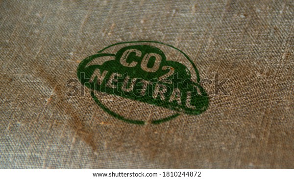 CO2 carbon neutral emission stamp printed on linen sack. Ecology, nature friendly, climate change, green fuel and earth protect concept.