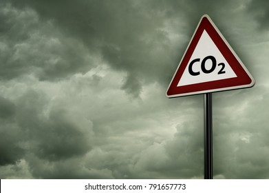co2 on roadsign under dark cloudy sky