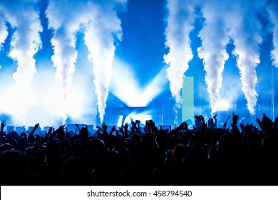 Co2 Smoke Cannons Silhouette of Crowd at a concert Music Festival - Backlit.
