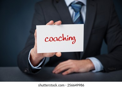 Coach advertisement concept. Man show card with text coaching.
