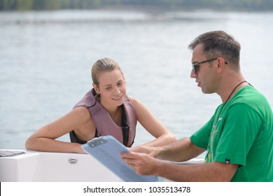 coach and athlete debriefing after water ski lesson